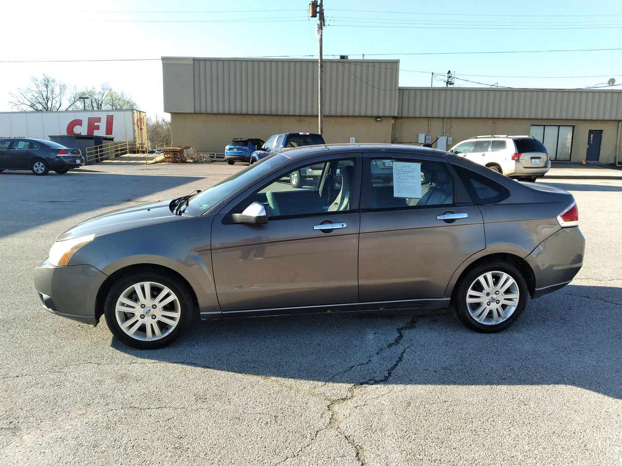 Pre-Owned 2010 FORD FOCUS SEL Sedan